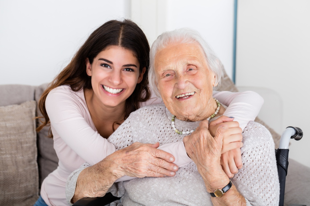 Two Women Embracing Each Other At Home